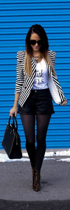 A statement blazer can be just as versatile as a basic one - especially when it's in black & white. Wear it with a graphic tee and black bottoms for an effortlessly cool look.