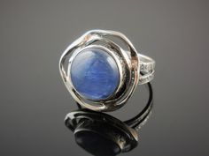 Made with Kyanite cabochon and sterling silver. Size 7.75