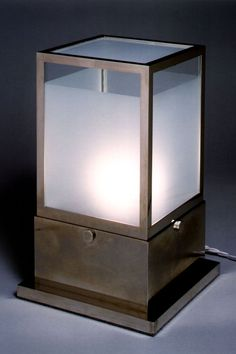 Traditionally handmade brass table lamp with frosted glass panes. Can be painted or nickel plated.