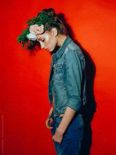 Fashion girl. Red background by Danil Nevsky #stocksy #realstock
