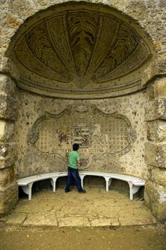 The seat and pebble mosaics in the Pebble Alcove at Stowe. ©National Trust Images/John MillarChild /  designed by William Kent at some point before 1739.