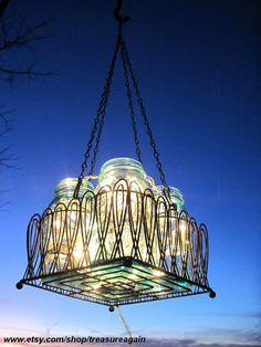 Mason Jar Chandelier Solar Lights, Antique Blue Mason Jars, Black Wire Basket, Upcycled Lighting, Weddings Spring Summer Garden Party. $109.50, via Etsy.