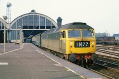 Brush Type 4 Co-Co D1982 stands at Darlington Bank Top on 1M77 15.42 Newcastle - Liverpool express with the secondman looking out for the tip to depart.   30th April 1968