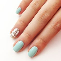 An Easy Winter Nail Art Idea Even Beginners Can Do: Add a little Winter sparkle to your nails with a festive snowflake accent nail.