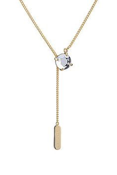With a logo embossed charm and a sparkling embellishment, this gold-plated necklace is a modern but minimal style from Maison Martin Margiela #Stylebop