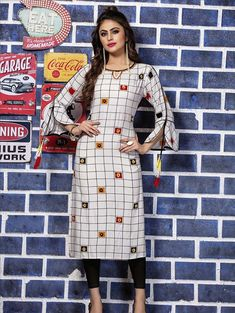 Grab this designer readymade kurti in white color fabricated on rayon. This kurti is beautified with thread work and prints. New Kurti Designs, Simple Kurta Designs, Stylish Dress Designs, Kurti Designs Party Wear, Salwar Designs, Stylish Dresses, Kurti Sleeves Design, Sleeves Designs For Dresses, Kurta Neck Design