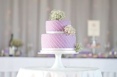 LOVELY LAVENDER WEDDING CAKE...HOWEVER SWITCH OUT THE BABY'S BREATH & MAKE MY DOTS ALIGN PERFECTLY
