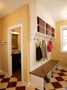Half bath in mud room-genius. Then when kids are playing outside they don't have to track dirt through the whole house to take a potty break.