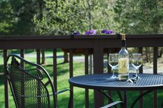 Enjoy some wine on your private deck at Shadow Mountain Escape