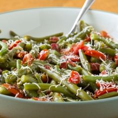 A wonderful green bean dish with bacon, tomatoes, and fresh parmesan cheese.