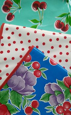 """(in store photo) Oilcloth Tablecloths from @bos2417 """"Oilcloth Alley"""" bright and cheery prints that we love! #oilcloth #cherries #polkadots #tesskitchenstore"""