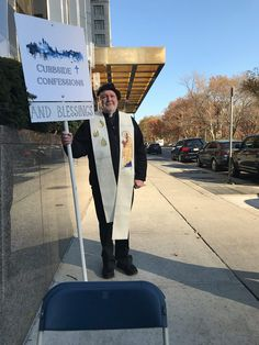Paulist Fr. John Collins offered curbside confessions and blessings at Columbus Circle in New York City. November, 2017.