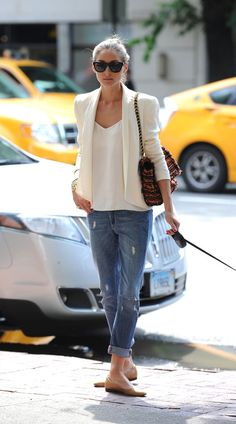 Olivia Palermo looking chic walking her dog