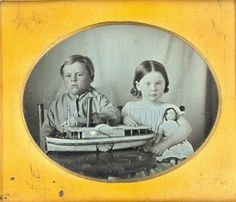 ca. 1848, daguerreotype portrait of two children with their toys ... The boy appears deceased.