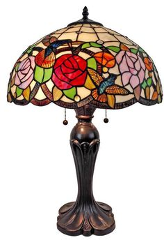 Add warmth to your home decor with this unique Tiffany-style table lamp. Spirited hummingbirds flitter in this beautiful garden scene on this multi-colored table lamp. This colorful lamp is sure to brighten any room. The classic Tiffany style has an air of sophistication and class, while the scene depicted adds a dash of whimsy. Tiffany Style Table Lamp by Rustica House. #myRustica