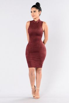 - Available in Burgundy, Taupe, and Blue - Suede Dress - Midi Length - Sleeveless - Mock Neck - Knotted Back - 92% Polyester 8% Spandex