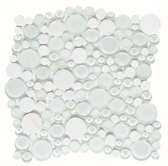 Dune: SNOW  Glass and stone mosaic in shades of white imitating snowflakes due to their different sizes