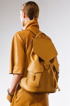 Beautiful tan leather tailored backpack and coat dress by Hermès for spring/summer 2013.