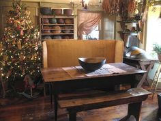 Beautiful Primitive Christmas Tree and Early American Interior ~ Great antique rocking horse under the tree and treenware collection, simple and country. by MotherHenNester