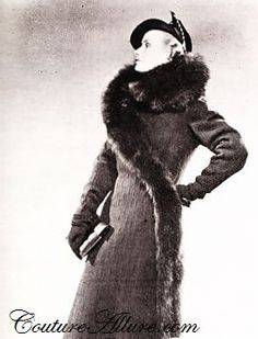 This is a wool coat with sable-dyed skunk fur swirls ảound the collar and across down to the hem design in 1936. During 1930s, garments include dress and coat were long at least to  mid-calf,fitted to the body and fur was very loved.
