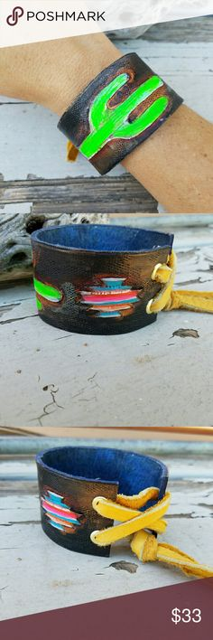 """Hand Tooled Cactus Leather Cuff This genuine leather cuff is handcrafted by me from start to finish.  Each of these leather cuff bracelets are tooled, hand painted, and stamped for a unique and individual piece of leather jewelry.  GUARANTEED  Length of cuff is 7.5""""  Slip this baby on and adjust with soft leather ties.  Leather ties are adjustable and one size will fit most.    Southwest vibes with rock and roll swag. Jewelry Bracelets"""