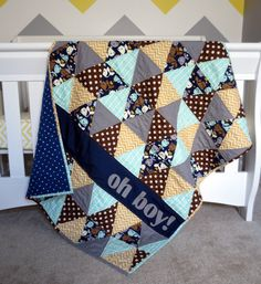 Blue Triangle Baby Quilt with Whales Blue Brown by LindySueSews Order a custom quilt here: https://www.etsy.com/listing/230381473/personalized-baby-quilt-triangle-baby?ref=shop_home_feat_2