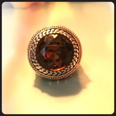 Gorgeous Ring set in two-tone gold, size 7 Big and beautiful chocolate brown stone with lots of sparkle. Set in ornate two tone setting. This is a size 7 but fits slightly smaller. Really pretty! I believe I got this at a Lia Sophia party. Jewelry Rings