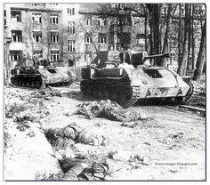 Spring 1944 in Belarus - Russian self-propelled guns SU-76M pass dead German soldiers.