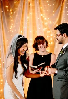 """Tulle and mini lights as wedding backdrop...a lot of """"bang for the buck."""" Looks like it costs much more than it does."""