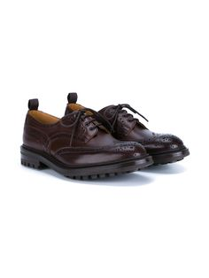 These chocolate brown Tricker's classic leather brogues seamlessly fuse practicality and style. Known to be the ultimate in heritage footwear, the designer fashions shoes that are adapted for both urban and rural lifestyles. The versatile and comfortable pair showcase leather insoles and thick ridged soles to ensure durability.