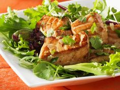 Salmon and Mixed Greens Salad with Walnuts~ 8 c mixed baby greens, baby lettuces, or mixed Mediterranean greens ¼ c chopped walnuts 1 Tbsp olive oil 1 tsp walnut oil 2 tsp balsamic vinegar ¼ tsp sea salt ¾ lb salmon fillet Ken's Lite Accents Honey Mustard salad spray