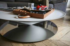 Float table designed by Luca Nichetto for La Chance in an arty and eclectic Parisian apartment - www. Table Furniture, Luxury Furniture, Parisian Apartment, Contemporary Coffee Table, A Perfect Circle, Project Board, Small Tables, Art Deco, Sculpture