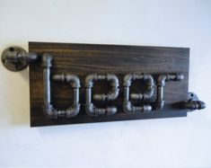 The Rampant A one of a kind design by Mobee Industrial Designs. An Industrial Black Pipe Beer Sign! A great addition to any Man Cave! The wood is