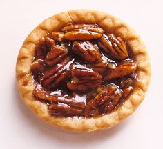 Granny's Mini Pecan Pie Tarts   Better Baking Bible Ingredients - 2 (3-ounce) packages cream cheese, softened - 2/3 cup unsalted butter, softened - 2 cups all-purpose flour - Pinch salt - 1 cup chopped pecans - 3 large eggs, beaten - 1 cup firmly packed dark brown sugar - 3/4 cup light corn syrup - 2 tbsp butter, melted - 1 teaspoon vanilla extract - 1/2 teaspoon salt