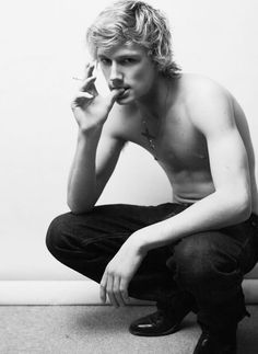 Alex Pettyfer...is that a cigarette? No matter, the point is that this picture is of Alex Pettyfer...and he seems to have lost his shirt somehow.