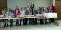 These fourth graders from troop 14177 collected enough cookies, sprinkles, frosting, cookies, and money to make baking kits for 104 families visiting a local food shelf. Great job and cool idea girls!