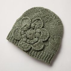 BEANIE IN BLOOM -- One flirtatious flower is all it takes. Hand woven in a viscose/polymide/cotton blend that gets its luxury from the addition of wool, cashmere and angora. One size fits most adults. Hats For Women, Clothes For Women, Cute Beanies, Ipad Photo, Loom Knitting, Knitting Ideas, Winter Headbands, Made Clothing, Hair Jewelry