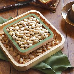 This solid wood pistachio server is designed to offer an elegant solution for storing discarded shells.