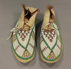 Sioux beaded mocassin's, white with yellow and green bead design, lace tops, adult size, Lakota, late 19th/early 20th cent.