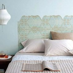 For the minimalist, wallpaper can be used to delineate a headboard in an otherwise austere room. Be warned, however, this project requires a bit of legwork. Research headboard shapes and find wallpaper that suits your room. Then, create a stencil and get to work!