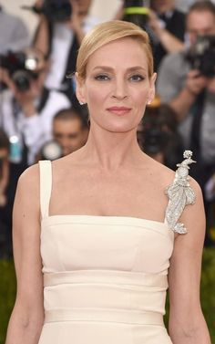 Image result for Peacock Brooch worn by Uma Thurman at the Met's Costume Institute Gala
