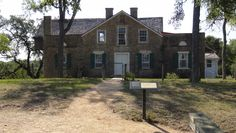 This is the front view of the old Kreische House located at Monument Hill State Park and Kreische Brewery State Historic Sites in La Grange, TX. This house was built by Heinrich Kreische who was the owner of Kreische Brewery. He also was a stone mason who built this house, his brewery, and a few of the stone buildings in La Grange.
