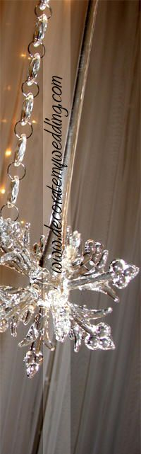 """CRYSTAL SNOWFLAKE DROPS  Exquisite three dimensional glass accents for your crystal wedding trees (and wonderful keepsake ornaments for your Christmas tree after the wedding!). These are absolutely stunning!   9"""" long 3 """" wide."""