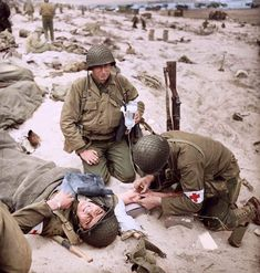 Medic's of the 4th Infantry Division taking care of another medic on Utah Beach after the landings on D-Day.