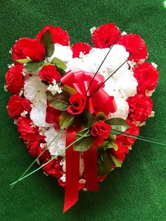 Cemetery flowers - cemetary flowers - fall cemetery flowers - christmas - flowers for grave - graves Christmas Flowers, Fall Flowers, Christmas Decorations, Grave Flowers, Cemetery Flowers, Cemetery Decorations, Carnations, Beautiful Christmas, Red Roses