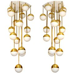 Pair of Pendants in the style of Stilnovo, circa 1970, Italy. | From a unique collection of antique and modern chandeliers and pendants  at http://www.1stdibs.com/furniture/lighting/chandeliers-pendant-lights/