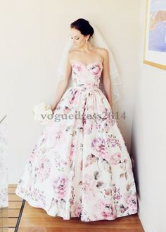For a feminine feel, you can't beat floral. This ladylike look is perfect for the bride who's looking for something unique. #weddingdress