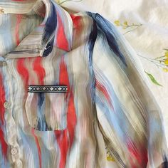 Multi colored striped button down. NWOT Multi colored striped button down. Ties at bottom! Never been worn! Fits S/M Tops