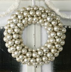 Silver Ball Wreath - you could also use silver mercury spray paint over styrofoam balls to make this WAY cheaper!