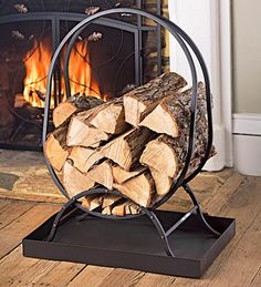 Oval Firewood Rack with Tray - stockpile logs in this stand on the porch by the back door; the accompanying tray catches wood chips